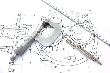 Micrometer compass and ruler on technical drawings
