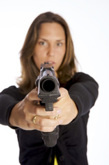 young woman armed with a gun