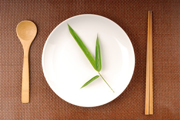 bamboo leaves on a white plate