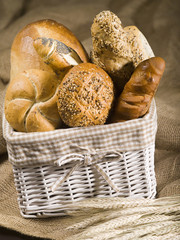 Bread and buns in a white basket