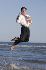 A young businessman jumping with joy