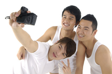 Asian young man taking a self portrait