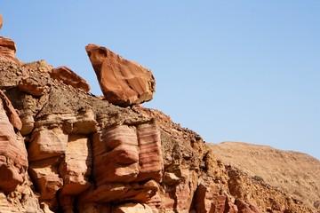 Picturesque unstable red rock in Negev desert, Israel