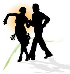 Silhouette of couple dancing latin with orange sun.