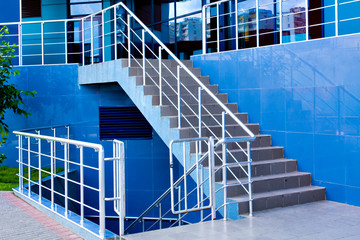 Marble staircase with a steel handrail