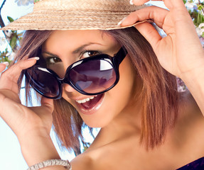 woman with  hat and sunglasses in summer time