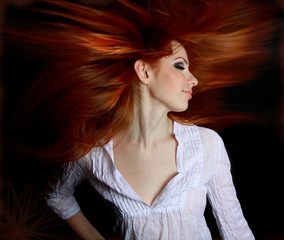 Pretty redhead young woman profile with hair streaming out behin