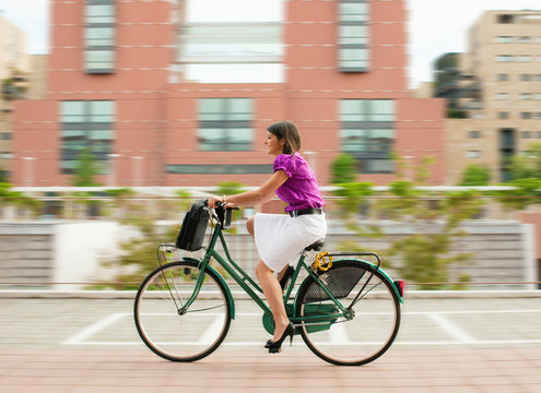 female commuter cycling