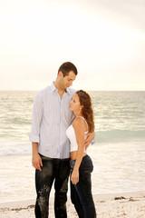 Tall man holding shorter woman