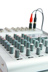 Controls of small sound mixer console with plug isolated