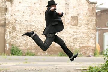 jumping man with gun