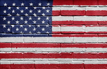 Flag of the USA painted onto a grunge brick wall