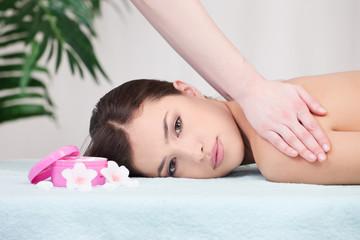 Pretty woman having back massage