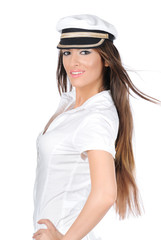 Beautiful woman in captains uniform with wind in the hair