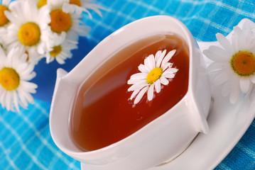 camomile tea in white cup