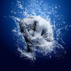 Water drops around men under water on blue background