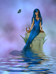 Foto op Aluminium Zeemeermin Blue Mermaid Sitting On A Pedastel In The Ocean