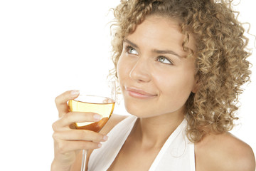 Young attractive curly haired woman drinking white wine