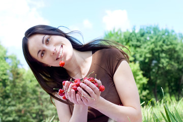 portrait of the happu girl with cherry