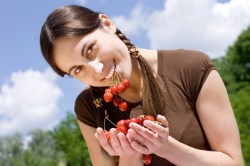 portrait of the happy girl with cherry