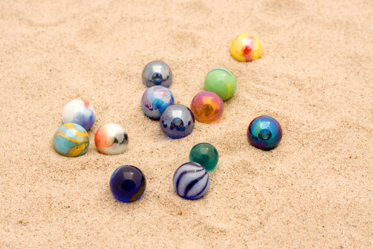 Marbles in sand