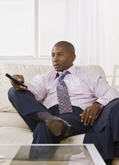 African American male watching TV