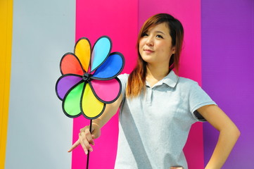 Beautiful Young Asian Woman With Colourful Fan
