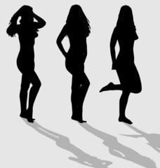 Vector silhouettes of three sexy female.