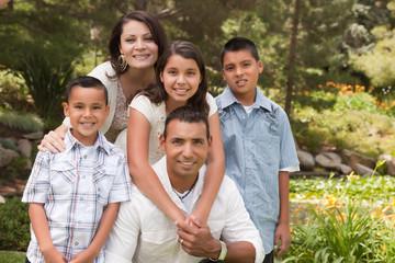 Happy Hispanic Family In the Park