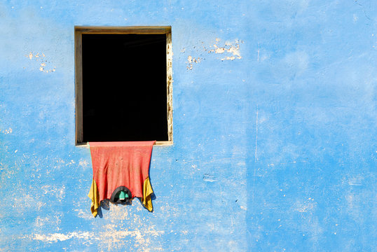 blue wall with shirt hanging to dry in baracoa, cuba