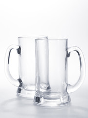 two empty mugs for beer on the table
