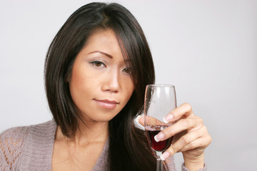 Lovely woman with red wine