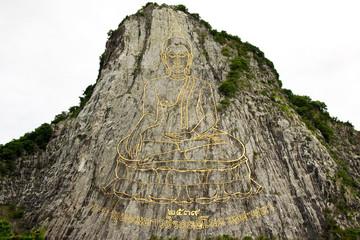 Engraving of Buddha image on mountain