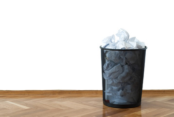 Full wastepaper basket with copy space