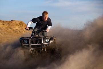 quad ATV - teenager kicking up dust