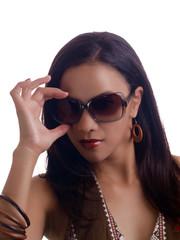 Young hispanic woman hand on sunglasses portrait