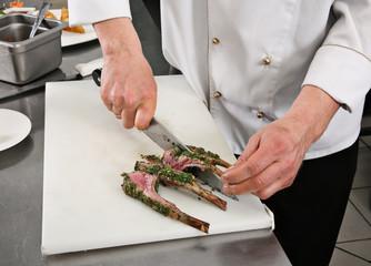 Chief cutting lamb rib