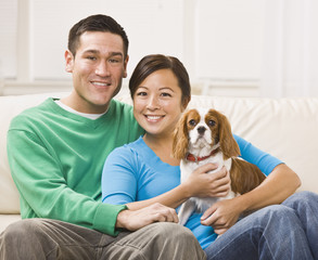 Attractive Asian Couple Holding Dog