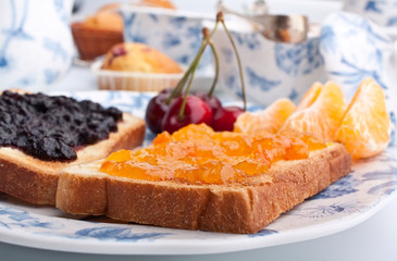 two toasts with jam