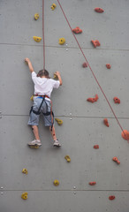 Girl climbing the wall