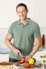 Man Preparing Meal In Kitchen