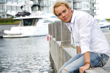 Young man near an exclusive yacht club