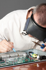 Engineer repairing circuit board