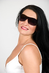 Elegant young woman with sunglasses