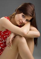 Young beautiful brunette woman sitting