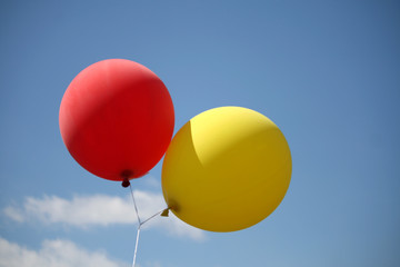 Red and yellow balloons in the sky