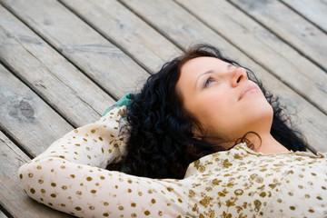 woman lying on wooden floor
