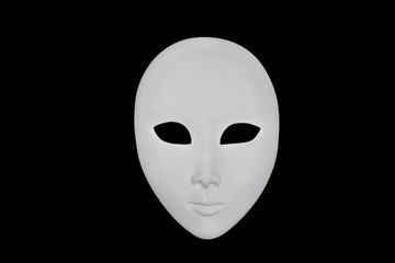 White face mask isolated over black