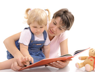 mother reads with her little daughter