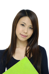 student portrait smiling and holding a green notebo